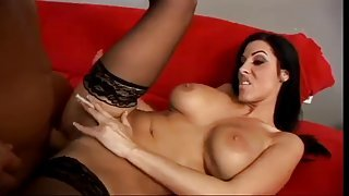 Brunette with black stockings fuck on sofa