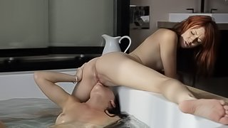 Sweet ladies are fucking in the bathtub