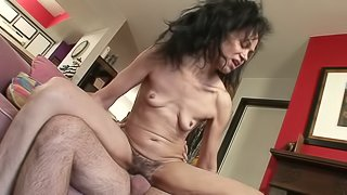 Mature brunette with flabby tits enjoys riding a cock