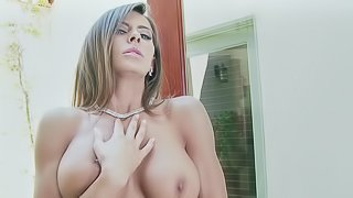 A girl with large tits parades her amazing rack in this video