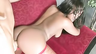 Ebony stripper in red fishnets rides cock and gets a fabulous fuck from behind.