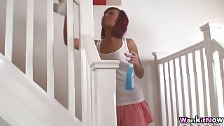 Super tanned babe cleaning house in a miniskirt