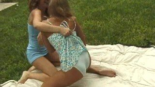 Two Girls Give Each Other a Wedgie