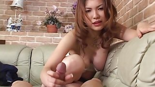 Huge breasted Japanese milf humping on a stiff dick on the sofa