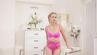 A girl is in her pink suit, getting her tits and pussy out