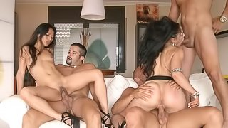Slutty friends fucking in a small orgy with eager guys