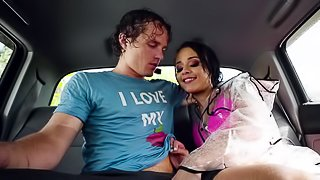 Wet chick in a rain coat blows him in the backseat