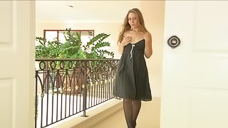 A sexy FTV model in stockings plays with her shaved pussy