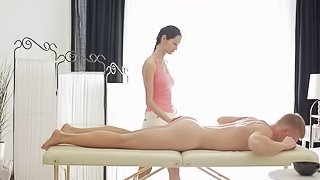 Sensual masseuse rides a client's cock and makes is jizz hard