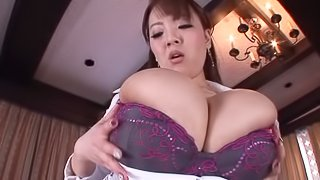 Busty Japanese milf enjoys pussy-eating and jumps on a cock