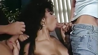 Puffy Hair Whore Sucking on Two Dongs