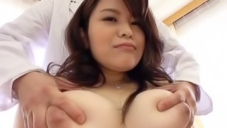 Busty Asian girl likes to moan while a friend fingers her cunt