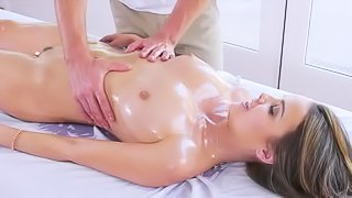 Oiled girl gets banged by masseur