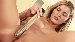 Goregous Paula toys her pussy with a golden dildo