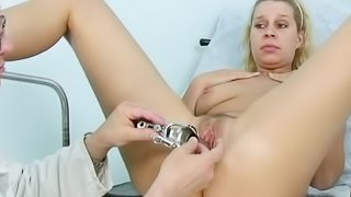 Blonde cutie having her pussy examined