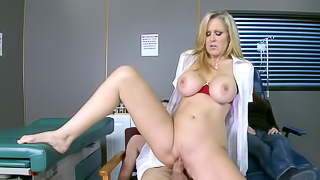 A blonde is doing her patient in the examination room before us