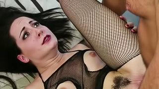 A hot lady with a bush on her pussy is getting pounded really hard