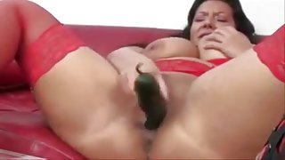 Busty cougar cream a cucumber..