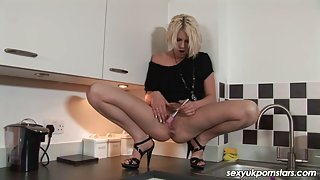 British blond pornstar Cyprus Isles receives off in the kitchen