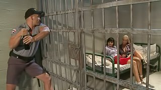 Angel Pink abd Jessica Moore share a cock in a jail