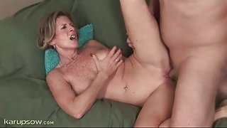 Freckled mom with sexy implants rides a cock