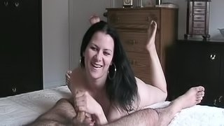 Cougar with natural tits giving massive dick superb handjob in homemade porn
