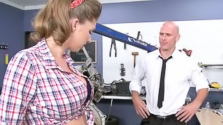 A Brunette With A Shaved Pussy Enjoying A Missionary Style Fuck In Her Boss's Office
