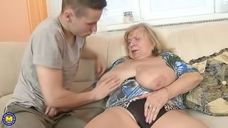 Big breasted granny doing her toyboy