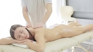 Turning on the pigtailed girl on his massage table and fucking her
