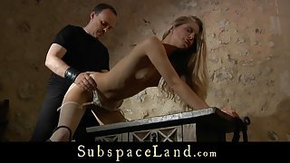 Slave girl dressed sexy for a high submission between ropes