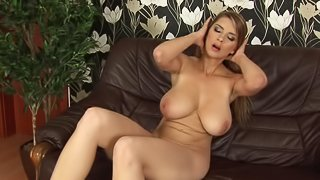 Big tits babe have her own style of masturbation