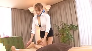 Nami Aino in miniskirt gives a sexy massages in reality film