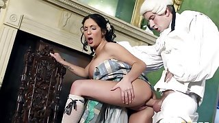 A medieval style video presents a busty brunette being nailed