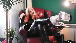 Hot blonde in latex and 10 inch heel smoking