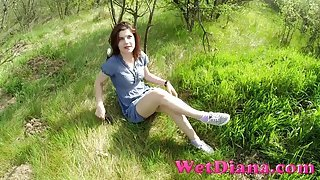Chick in a pretty dress flashing panties in the grass
