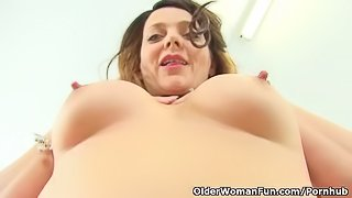 English milf Gemma Gold pushes her fingers in