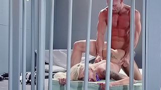 A blonde hottie is getting fucked really hard in the prison