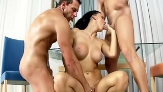 Two large men are penetrating a hot chick with huge knockers