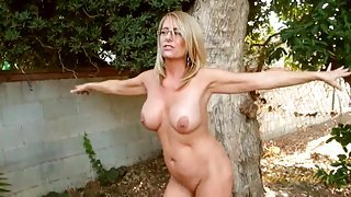 Busty milf chatting it up in the backyard