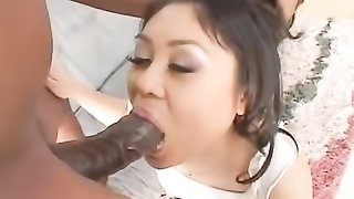 Magnetic, Asian girl in white top and panties rubs her wet cunt before blowing and riding guy's BBC on grey couch.