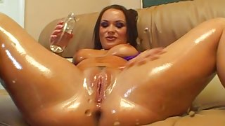 Horny slut oils up before getting some interracial love