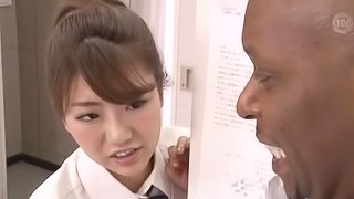 Black bod screwing a Japanese cutie making her moan loudly
