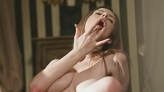 A brunette girl that loves to parade her nude flesh is jacking off