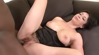 Mature woman gets to ride a horny black fellow's fat cock