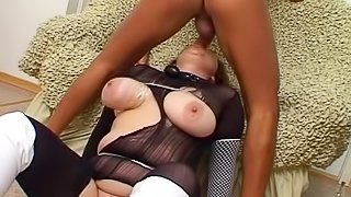 Redhead granny is getting fucked through the hole