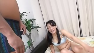 Mature Japanese tart rubs a BBC and gets banged doggy style