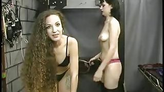 Two kinky babes take turns spanking each other in the dungeon