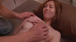 He gives Japanese girl a massage and rubs her tits
