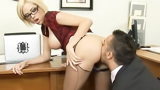 Horny boss rips open the pantyhose of quiet, blonde secretary in dark red blouse and glasses and takes her on her desk.