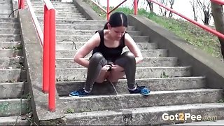 Sexy skintight leggings on a public pissing girl
